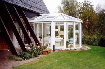 Пристройка к дому зимнего сада